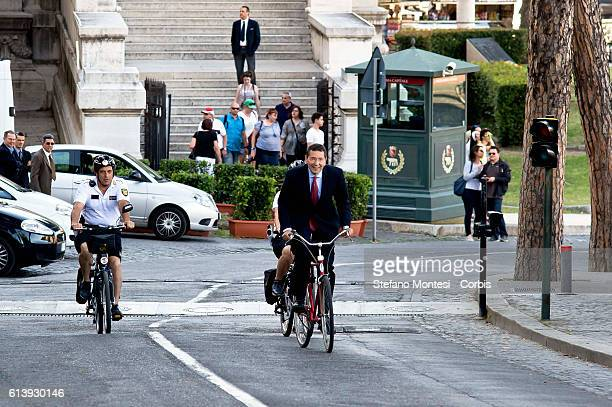 Ignazio Marino new Mayor of Rome arrives escorted by two municipal police officers on bicycles at the Capitol for the handover with the outgoing...