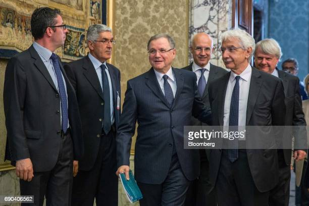 Ignazio Visco Bank of Italy Governor center and Salvatore Rossi Bank of Italy senior deputy governor right arrive to attend the Bank of Italy's...