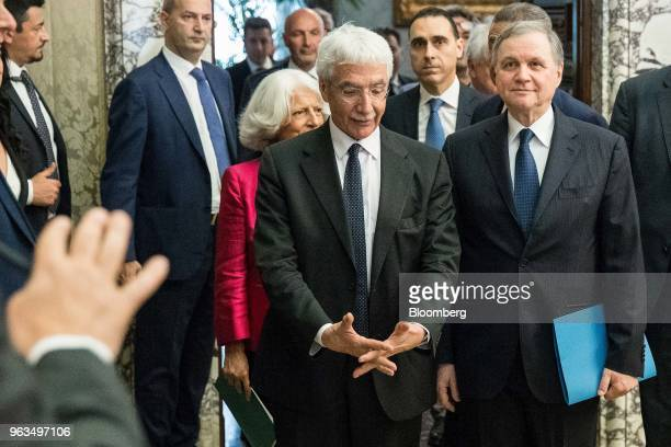 Ignazio Visco governor of Bank of Italy right and Salvatore Rossi Bank of Italy senior deputy governor center arrive to attend the central bank's...