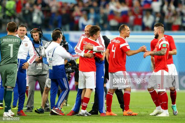 Igor Akinfeev Aleksandr Golovin Sergey Ignashevich and Ilya Kutepov of Russia celebrates victor following the 2018 FIFA World Cup Russia group A...
