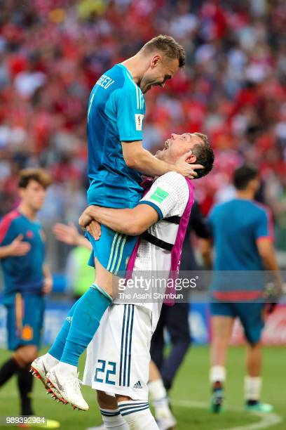 Igor Akinfeev and Artyom Dzyuba of Russian celebrate their victory through the penalty shootout in the 2018 FIFA World Cup Russia Round of 16 match...