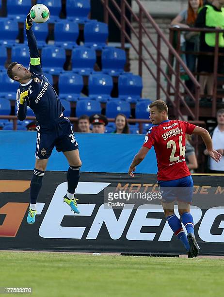 Igor Akinfeev and Vasili Berezutski of PFC CSKA Moscow during the Russian Premier League match between FC Tom Tomsk and PFC CSKA Moscow at Trud...