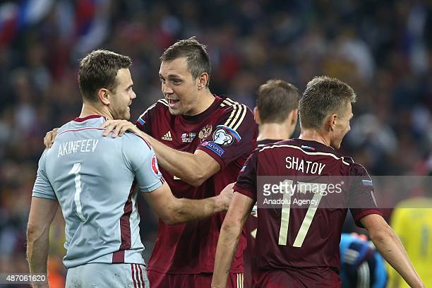 Igor Akinfeev Artem Dzyuba and Oleg Shatov of Russia after the UEFA Euro 2016 qualifying round Group G football match at Otkritie stadium in Moscow...