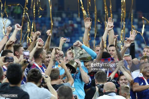 Igor Akinfeev CSKA Moscow's goalkeeper seen holding the trophy while celebrating the victory with his teammate for winning the 2018 Russian Super Cup...