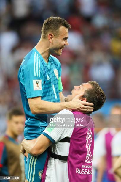 Igor Akinfeev of Russia celebrates after his team's victory in a penalty shootout during the 2018 FIFA World Cup Russia Round of 16 match between...