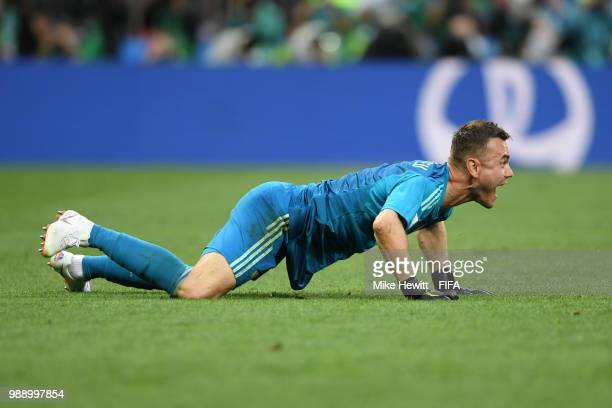 Igor Akinfeev of Russia celebrates his team's victory following the 2018 FIFA World Cup Russia Round of 16 match between Spain and Russia at Luzhniki...