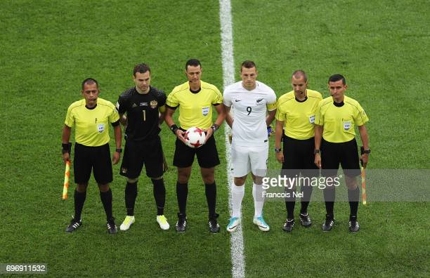 Igor Akinfeev of Russia Chris Wood of New Zealand and referees line up for the photos prior to the FIFA Confederations Cup Russia 2017 Group A match...