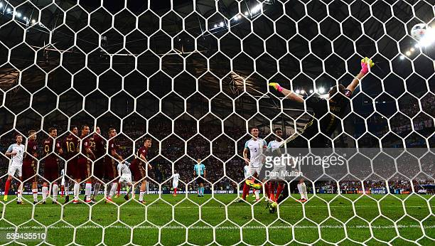 Igor Akinfeev of Russia dives in vain as Eric Dier of England scores his team's first goal during the UEFA EURO 2016 Group B match between England...