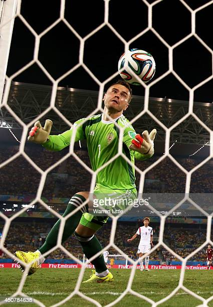 Igor Akinfeev of Russia fails to save a shot by Lee KeunHo of South Korea for South Korea's first goal during the 2014 FIFA World Cup Brazil Group H...
