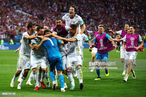 Igor Akinfeev of Russia is congratulated by his teammates after the penalty shootout following the 2018 FIFA World Cup Russia Round of 16 match...