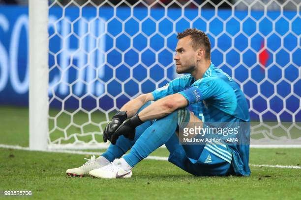 Igor Akinfeev of Russia looks dejected after losing in a penalty shootout during the 2018 FIFA World Cup Russia Quarter Final match between Russia...