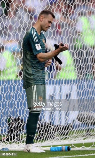 Igor Akinfeev of Russia looks dejected following the 2018 FIFA World Cup Russia group A match between Uruguay and Russia at Samara Arena on June 25...
