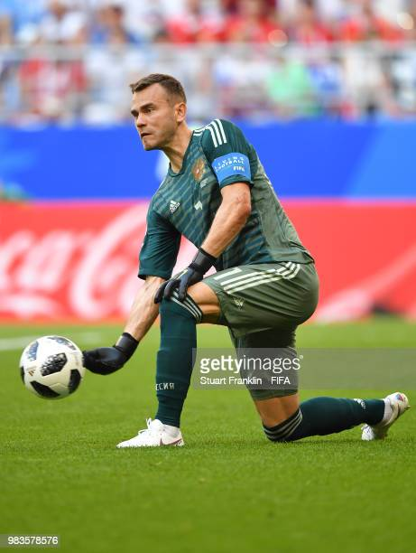 Igor Akinfeev of Russia rolls out the ball during the 2018 FIFA World Cup Russia group A match between Uruguay and Russia at Samara Arena on June 25...