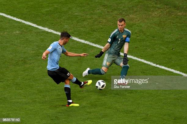 Igor Akinfeev of Russia saves an effort from Rodrigo Bentancur of Uruguay during the 2018 FIFA World Cup Russia group A match between Uruguay and...