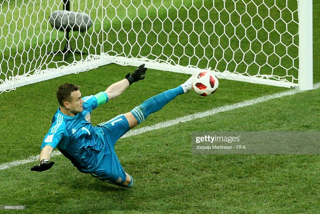 Igor Akinfeev of Russia saves the fifth penalty from Iago Aspas of Spain in the penalty shoot out during the 2018 FIFA World Cup Russia Round of 16 match between Spain and Russia at Luzhniki Stadium on July 1, 2018 in Moscow, Russia.