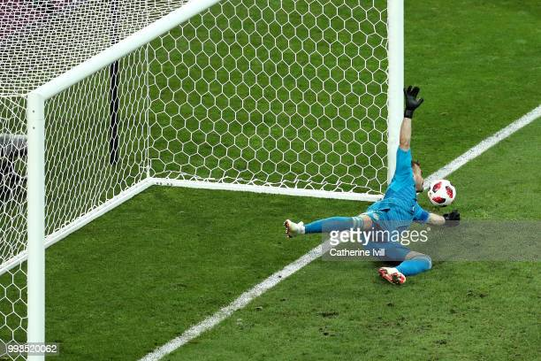 Igor Akinfeev of Russia saves the second penalty from Mateo Kovacic of Croatia in the penalty shoot out during the 2018 FIFA World Cup Russia Quarter...