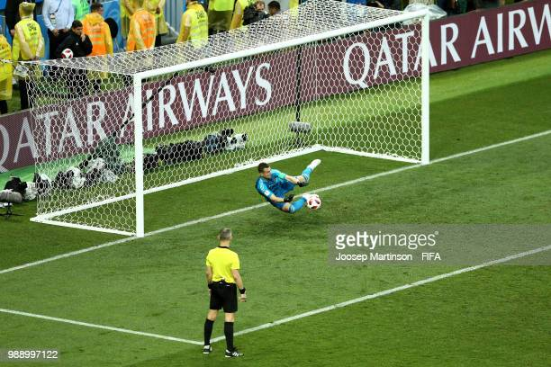 Igor Akinfeev of Russia saves the third penalty from Koke of Spain in the penalty shoot out during the 2018 FIFA World Cup Russia Round of 16 match...