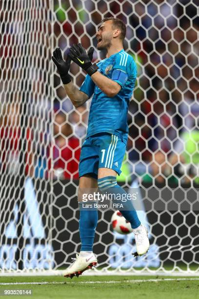 Igor Akinfeev of Russia shows his frustration in the penalty shoot out during the 2018 FIFA World Cup Russia Quarter Final match between Russia and...