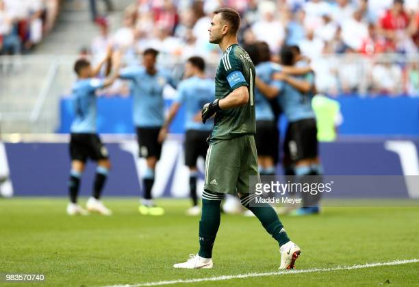 Igor Akinfeev of Russia stands dejected after the second Uruguay goal scored by Diego Laxalt during the 2018 FIFA World Cup Russia group A match...