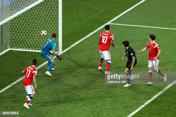 Igor Akinfeev of Russia watches on as Domagoj Vida of Croatia's header crosses the line for Croatia's second goal during the 2018 FIFA World Cup...