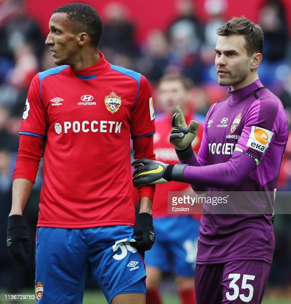 Igor Akinfeev talks with Rodrigo Becao of PFC CSKA Moscow during the Russian Premier League match between PFC CSKA Moscow and FC Orenburg on April...