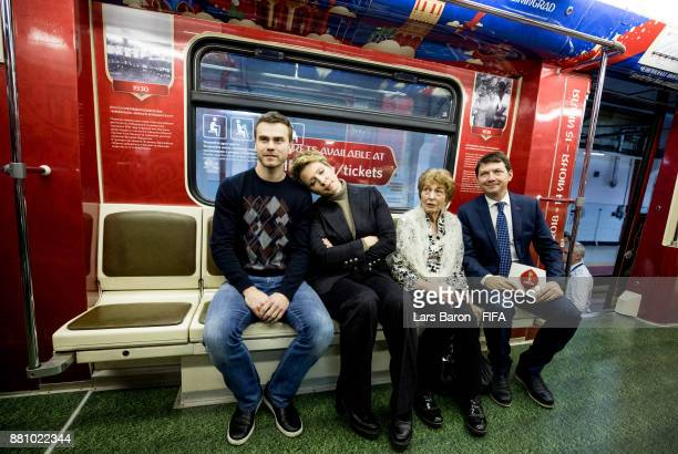 Igor Akinfeev Yana Churikov and Valentina Yashina pose for a picture during the FIFA World Cup Russia Official Poster launch at Krasnaya Presnya...