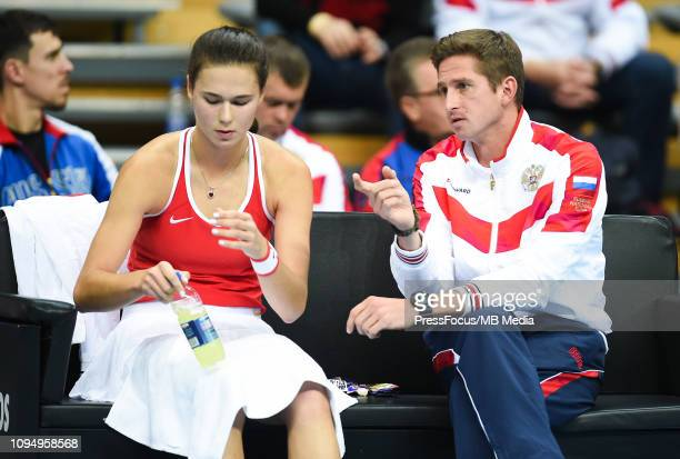 Igor Andreev captain of team of Russia and Natalia Vikhlyantseva of Russiareacts during her match against Clara Tauson of Denmark during the Fed Cup...