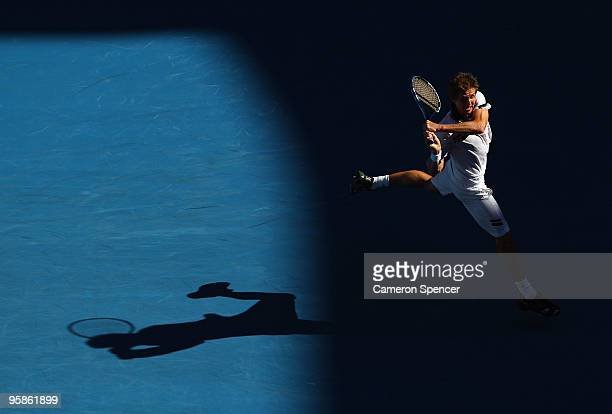 Igor Andreev of Russia plays a backhand in his first round match against Roger Federer of Switzerland during day two of the 2010 Australian Open at...