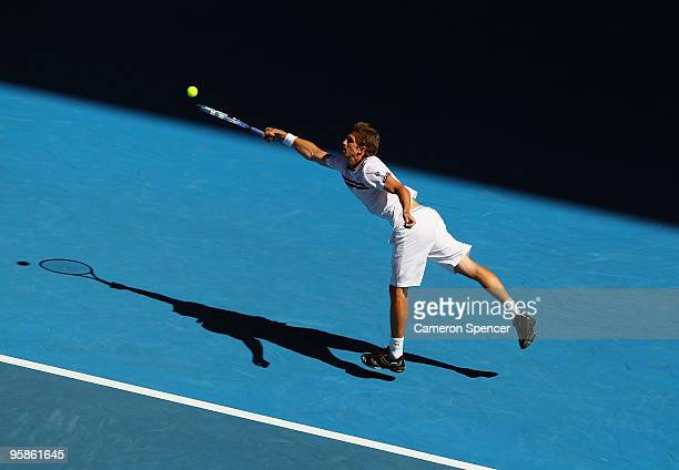 Igor Andreev of Russia plays a forehand in his first round match against Roger Federer of Switzerland during day two of the 2010 Australian Open at...