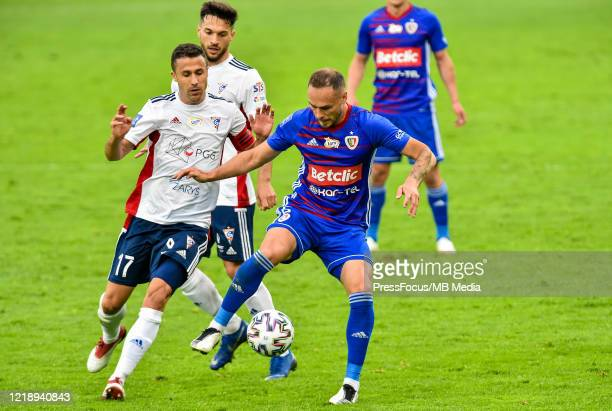 Igor Angulo of Gornik and Tom Hateley of Piast compete for the ball during the PKO Ekstraklasa match between Gornika Zabrze and Piast Gliwice at...