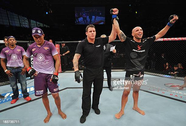 Igor Araujo celebrates after defeating Ildemar Alcantara in their welterweight bout during the UFC Fight Night event at the Ginasio Jose Correa on...