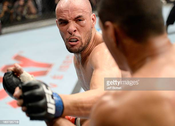 Igor Araujo punches Ildemar Alcantara in their welterweight bout during the UFC Fight Night event at the Ginasio Jose Correa on October 9, 2013 in...
