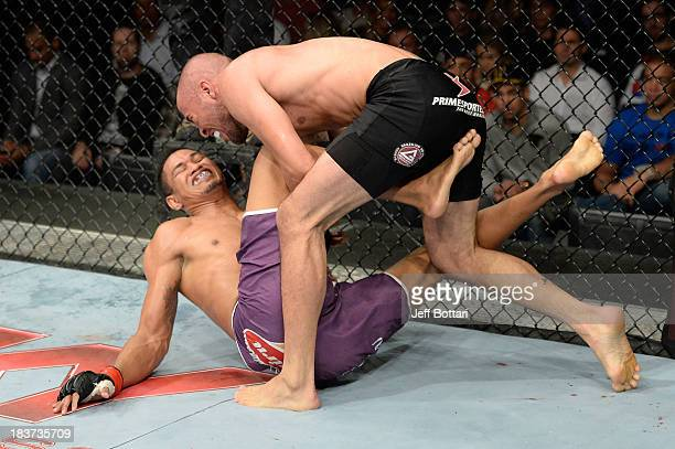 Igor Araujo takes down Ildemar Alcantara in their welterweight bout during the UFC Fight Night event at the Ginasio Jose Correa on October 9, 2013 in...