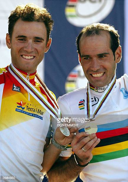 Igor Astarloa of Spain holds his gold medal while Alejandro Valverde of Spain holds his silver medal in the men''s individual road race 12 October...