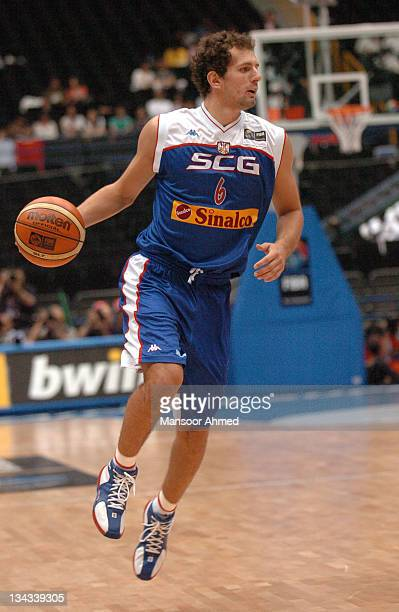 Igor Avdalovic of Serbia looks to pass inside versus Spain during the FIBA World Championship 2006 Final Eight at the Saitama Super Arena Tokyo Japan...