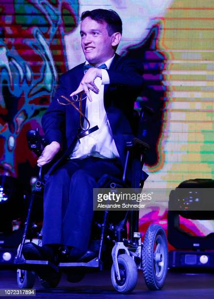 Igor Barcellos paralympic athlete poses for photo after winning the fans choice during the Brazil Paralympics Awards Ceremony 2018 at Paralympic...
