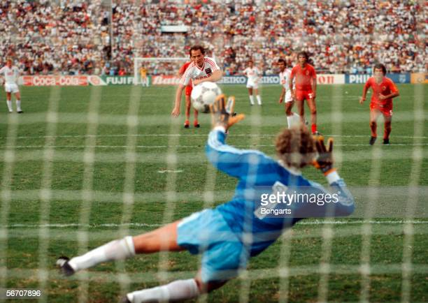 Igor Belanov of Soviet Union scores his third goal by penalty kick against goalkeeper JeanMarie Paff of Belgium during the World Cup eigth final...