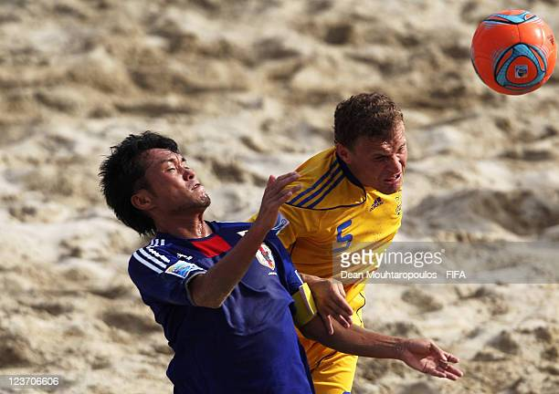 Igor Borsuk of Ukraine and Takeshi Kawaharazuka of Japan battle for the ball during the FIFA Beach Soccer World Cup Group D match between Ukraine and...