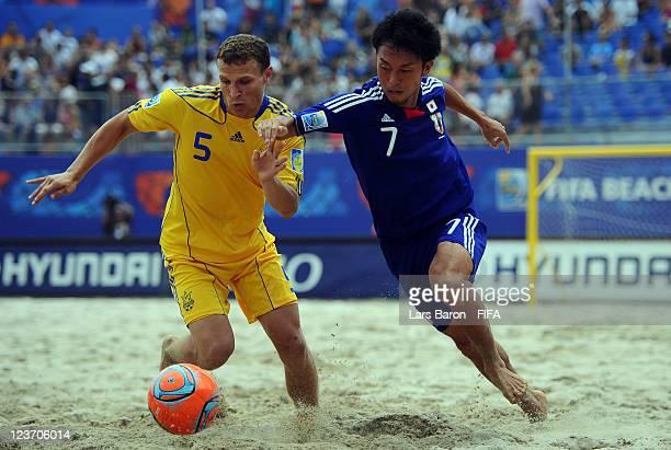 Igor Borsuk of Ukraine challenges Takeshi Kawaharazuka of Japan during the FIFA Beach Soccer World Cup Group D match between Ukraine and Japan at...