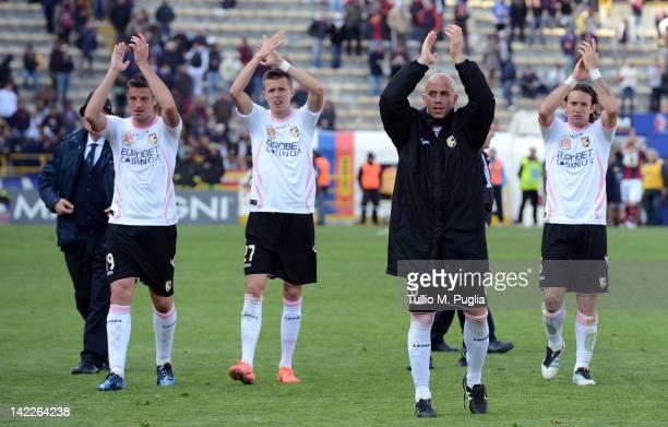 Igor Budan Josip Ilicic Giulio Migliaccio and Edgar Barreto greet supporters after winning the Serie A match between Bologna FC and US Citta di...
