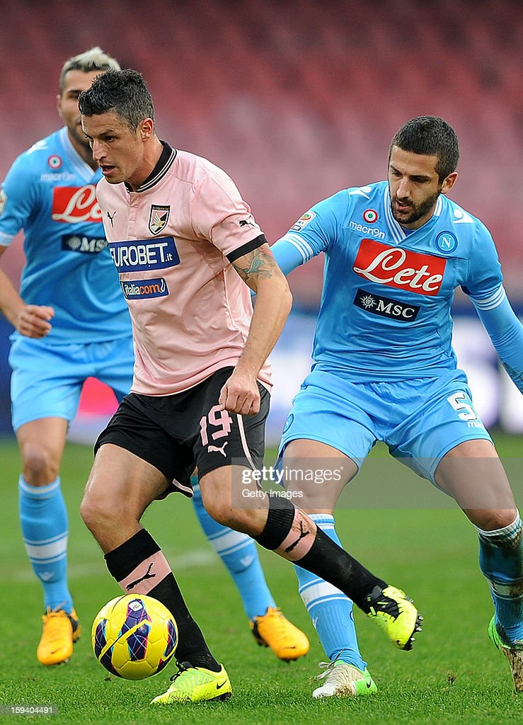 Igor Budan of Palermo (L) competes with Miguel Angel Britos of Napoli during the Serie A match between SSC Napoli and US Citta di Palermo at Stadio San Paolo on January 13, 2013 in Naples, Italy.