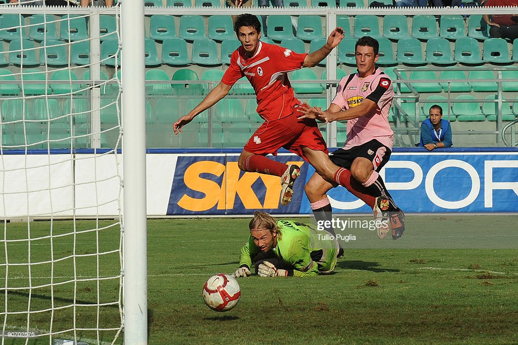 Igor Budan (R) of Palermo scores a equalising goal as Jean Francois Gillet (Down) and Andrea Ranocchia (Top) react during the Serie A match played between US Citta di Palermo and AS Bari at Stadio Renzo Barbera on September 13, 2009 in Palermo, Italy.