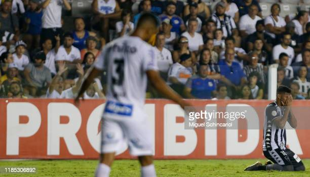Igor Cassio of Botafogo celebrates after scoring his team's first goal during a match between Santos and Botafogo for the Brasileirao Series A 2019...