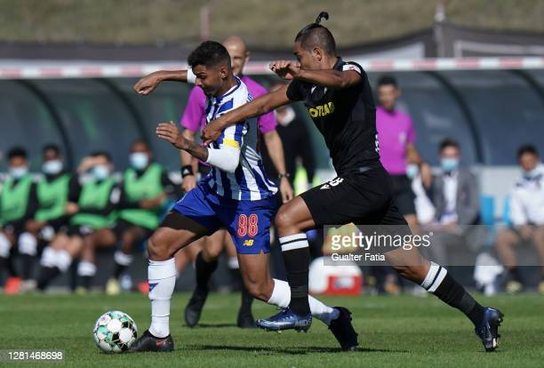 Igor Cassio of FC Porto B with Christian of Casa Pia AC in action during the Liga Pro match between Casa Pia AC and FC Porto B at Estadio Pina...