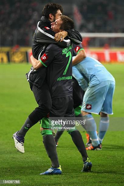 Igor de Camargo and Patrick Herrmann Patrick Herrmann celebrate the 30 victory after the Bundesliga match between 1 FC Koeln and Borussia...