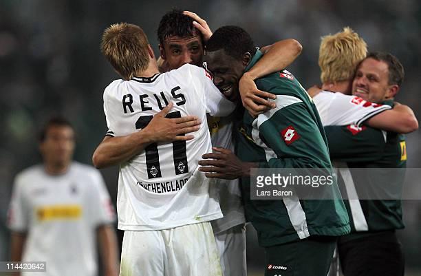 Igor de Camargo fo Moenchengladbach who scored the winning goal celebrates with Marco Reus and Mohamadou Idrissou after winning the Bundesliga play...