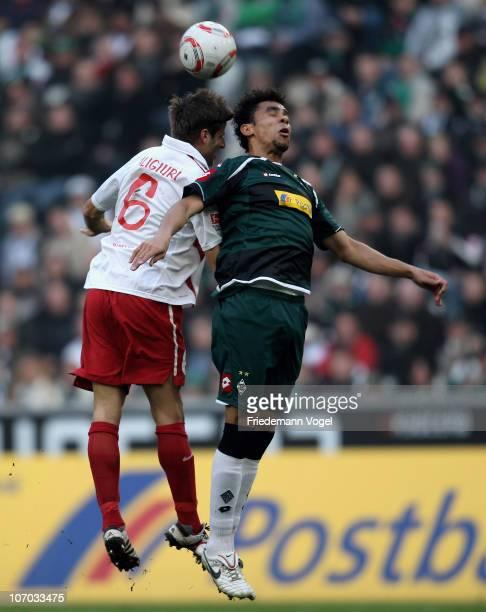 Igor de Camargo of Gladbach and Marco Caligiuri of Mainz battle for the ball during the Bundesliga match between Borussia M'gladbach and FSV Mainz 05...