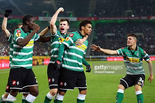 Igor de Camargo of Moenchengladbach celebrates the first goal with Peniel Mlapa Havard Nordtveit and Granit Xhaka of Moenchengladbach during the UEFA...