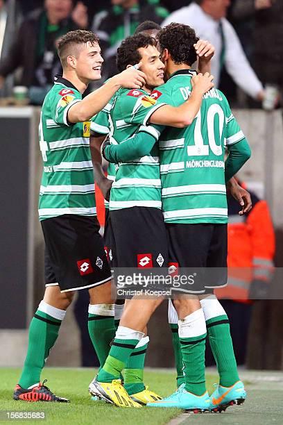 Igor de Camargo of Moenchengladbach celebrates the first goal with Granit Xhaka and Juan Arango during the UEFA Europa League group C match between...