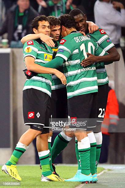 Igor de Camargo of Moenchengladbach celebrates the second goal with Juan Arango Granit Xhaka and Peniel Mlapa of Moenchengladbach during the UEFA...
